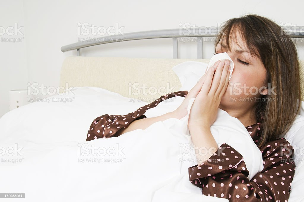 Poorly Sick in Bed royalty-free stock photo
