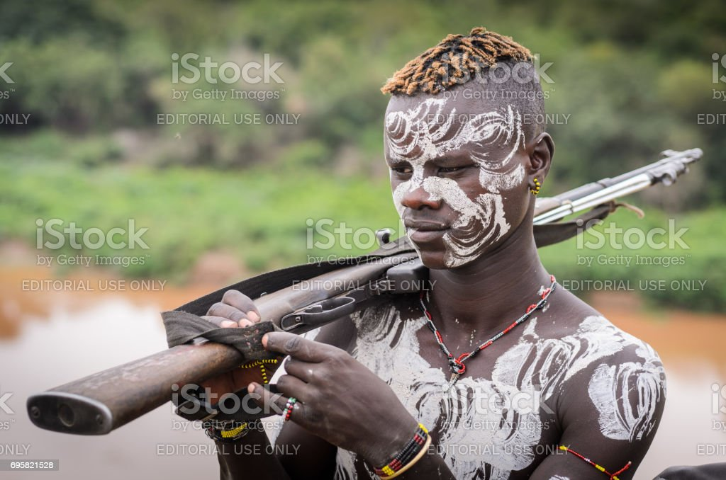 Poortrait of Karo tribe man with a gun stock photo