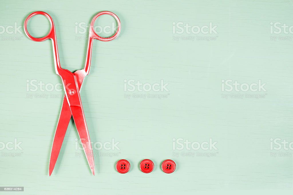 Pop art. Scissors and buttons on close up on wooden board stock photo