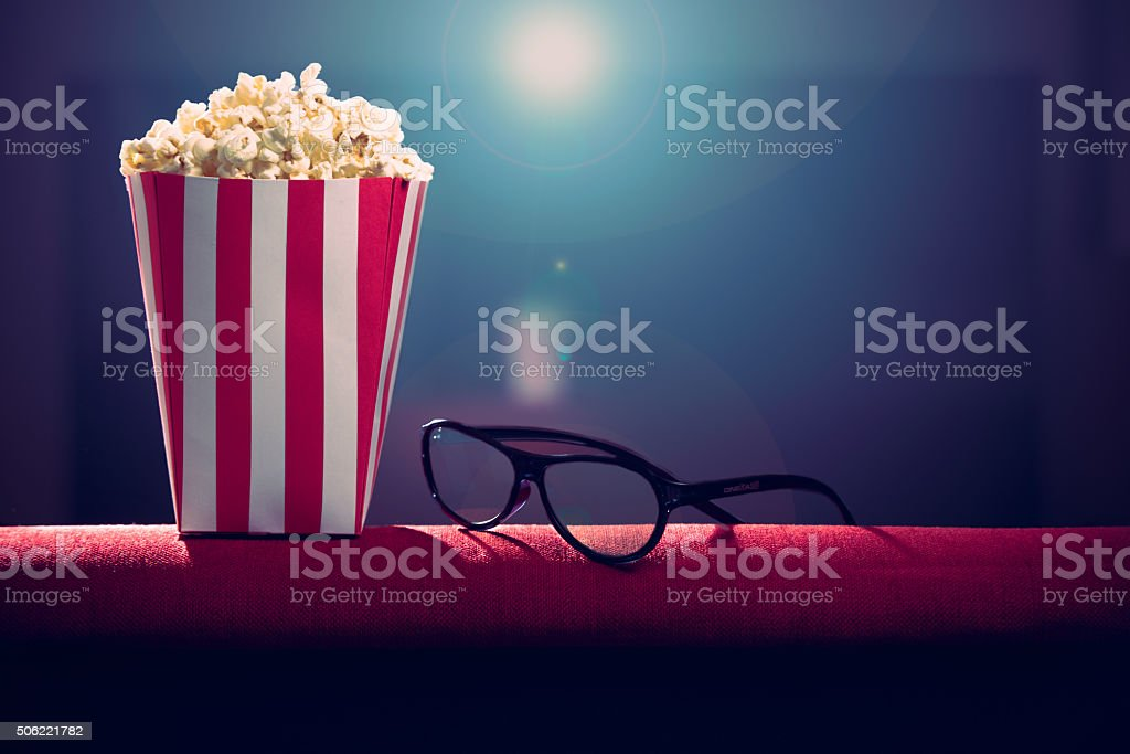 pop corn on armchair cinema stock photo