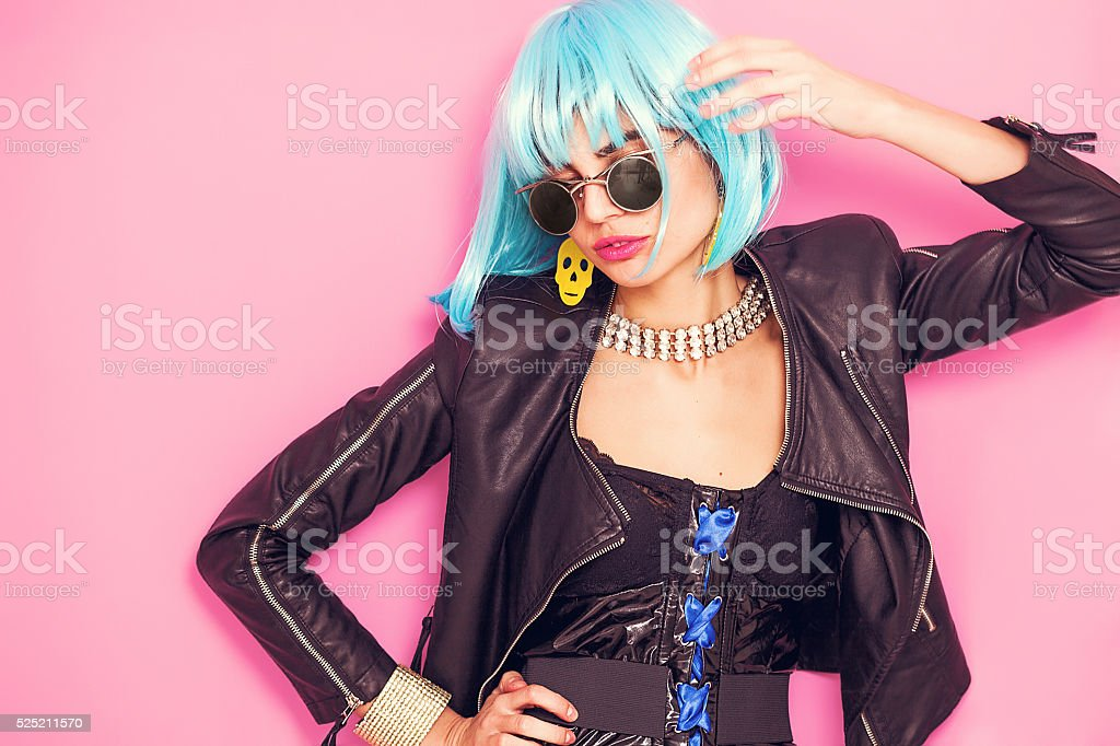 Pop girl portrait wearing weird accessories and posing stock photo