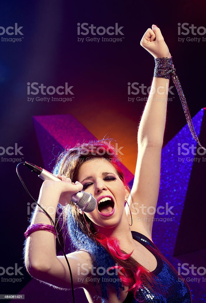 Pop star with hand raised stock photo