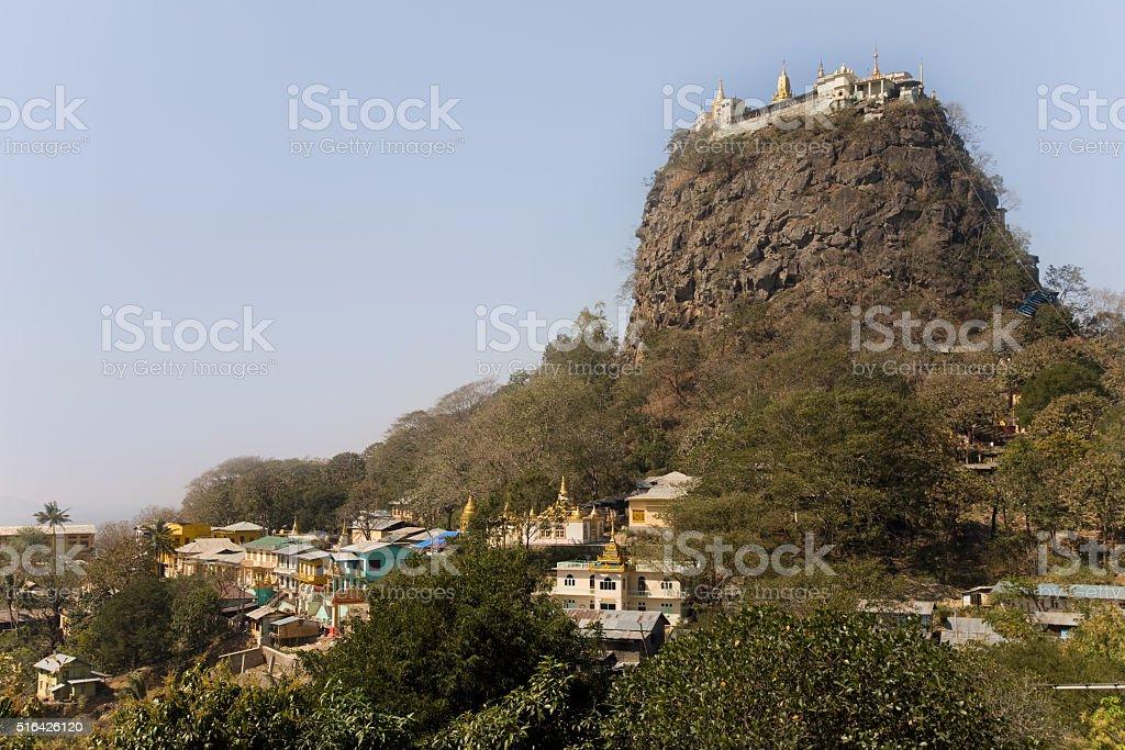 Popa Taungkalat monastery atop an outcrop of Mount Popa volcano, stock photo