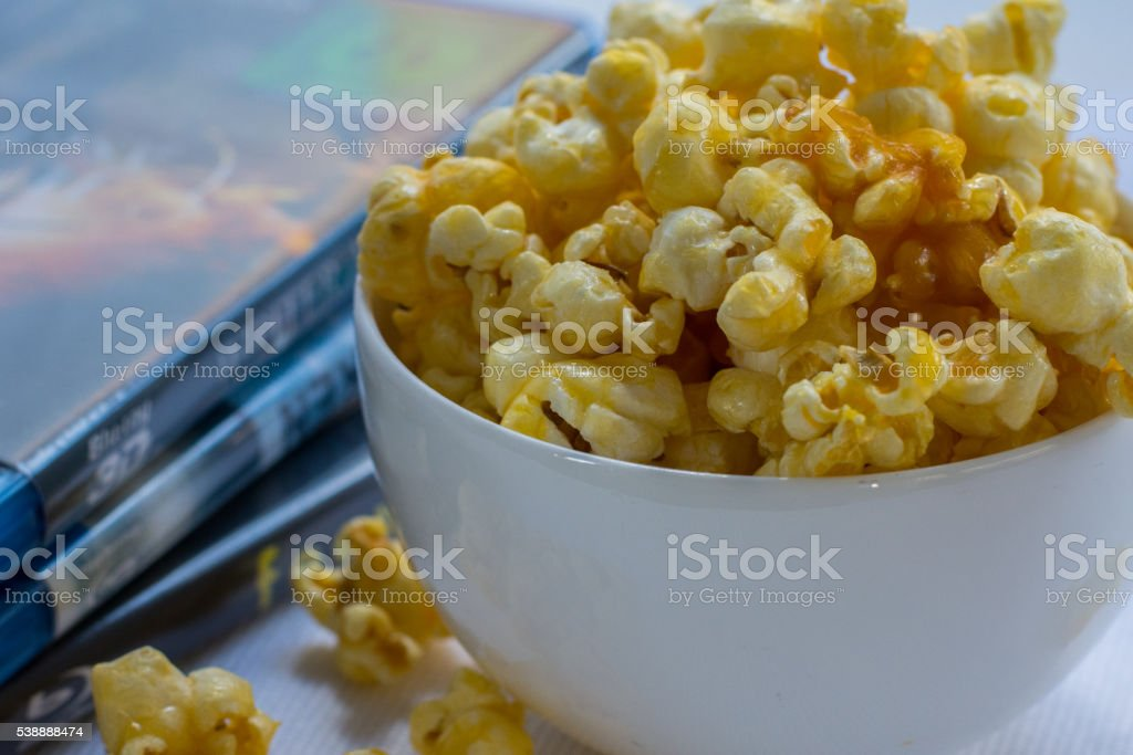 Popcorn and DVD's stock photo