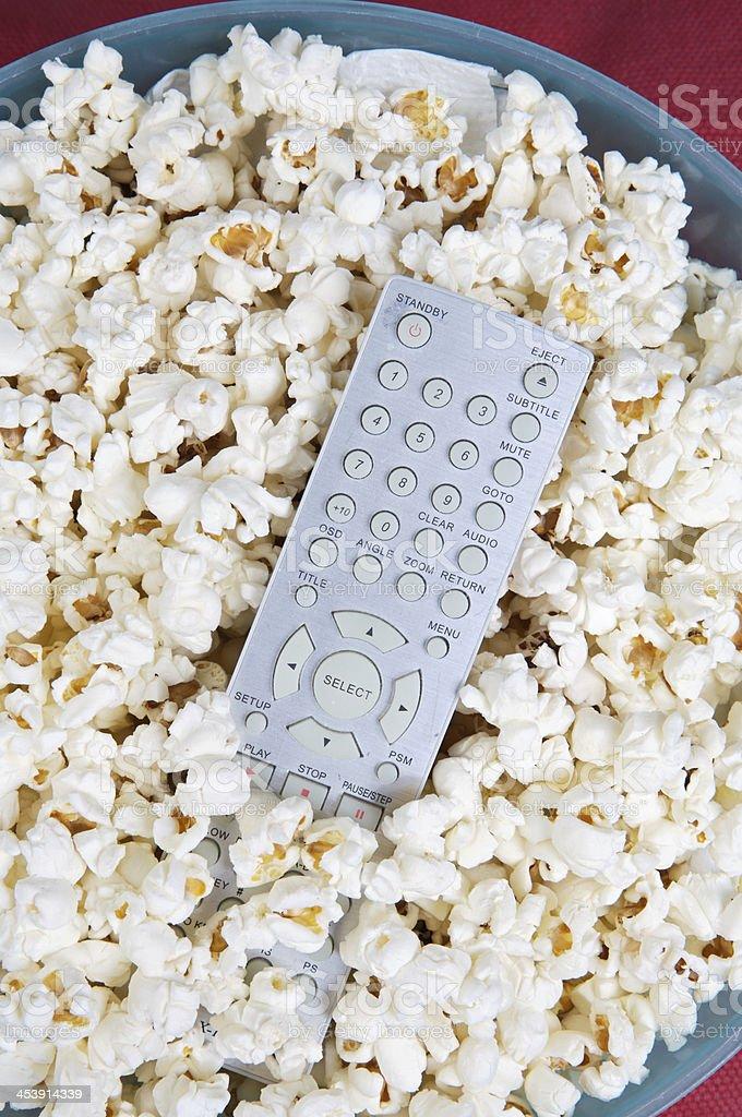 Popcorn and remote control stock photo
