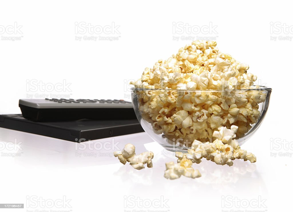 Popcorn and remote. royalty-free stock photo