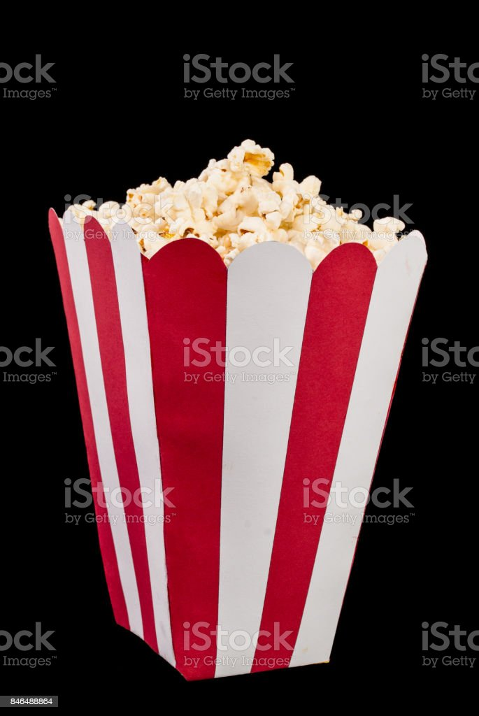 Popcorn box in red and white color on black background stock photo