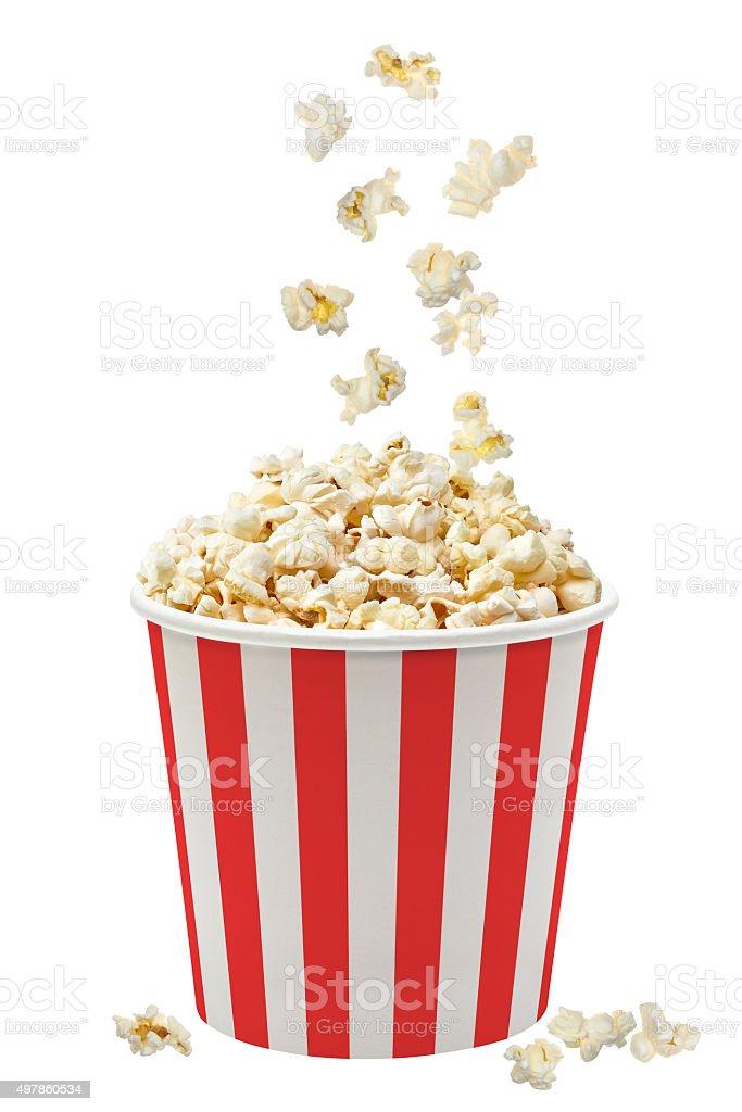 Popcorn falling in striped bucket stock photo