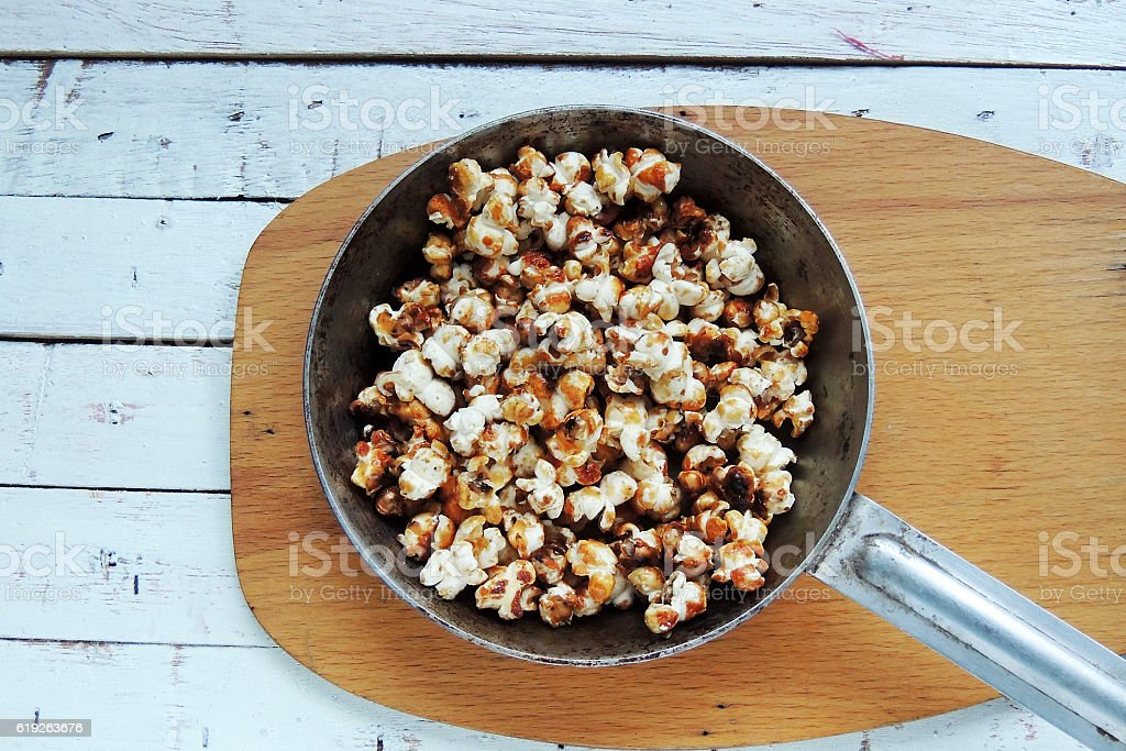 Popcorn in a pan stock photo