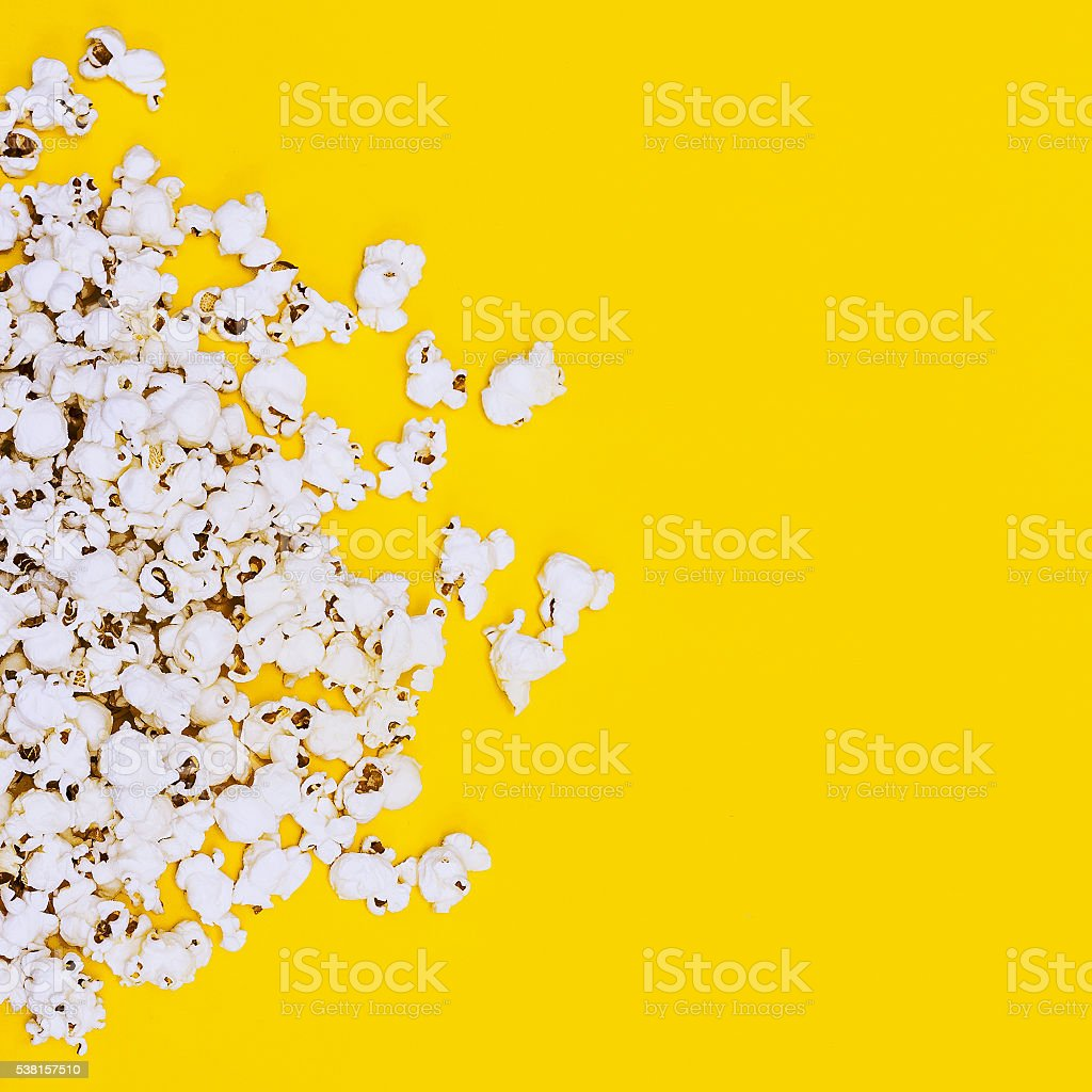 Popcorn on yellow background. Minimalism fashion detail. stock photo