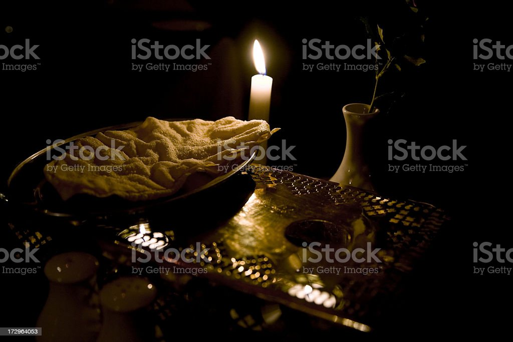 Poppadoms, Food Warmer and Vase on Candlelit Indian Restaurant Table. stock photo