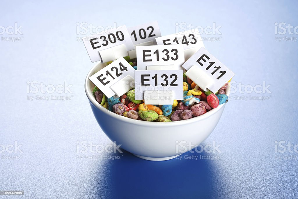 Popped wheat seeds full with food additive stock photo