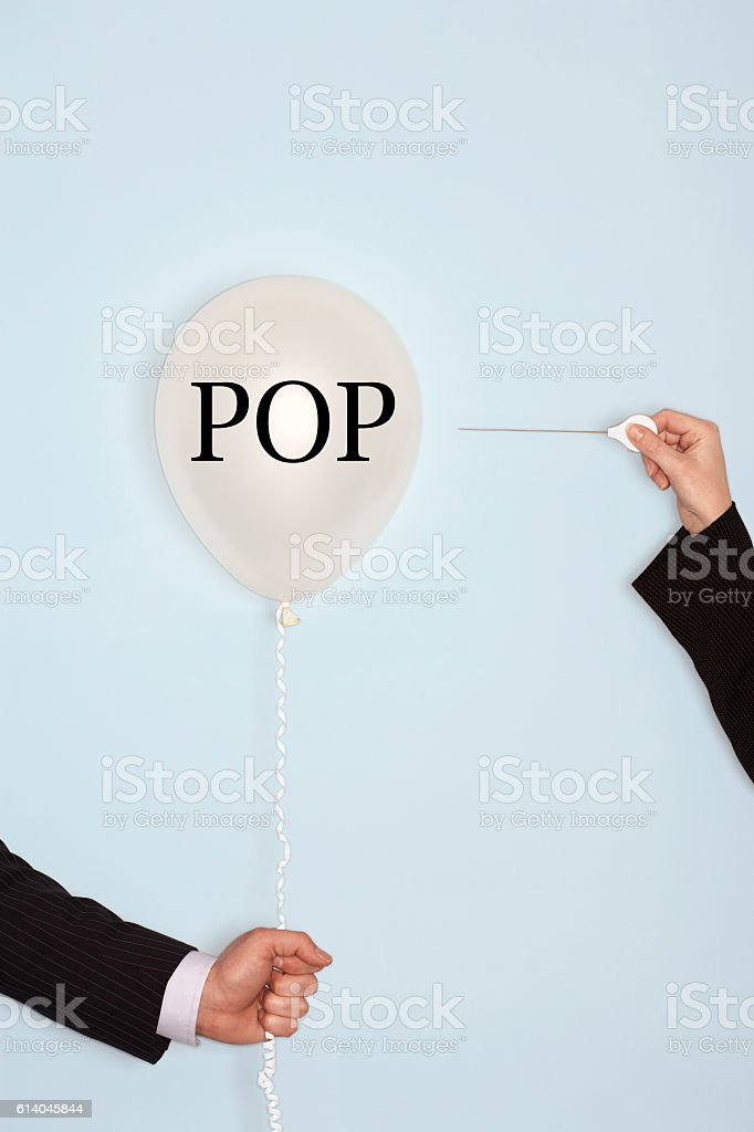 Popping balloon with text saying POP stock photo