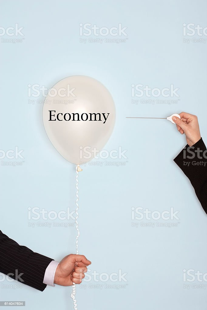 Popping balloon with the text saying Economy stock photo