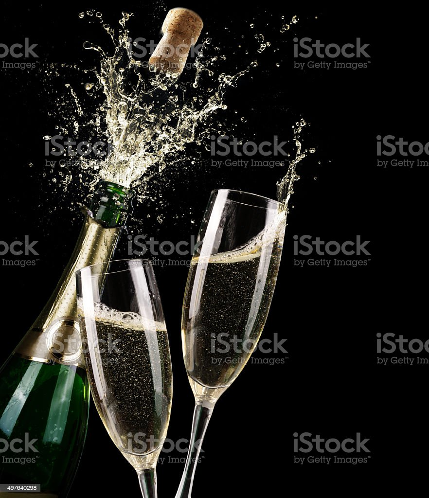 Popping Champagne And Toast Of Midnight stock photo