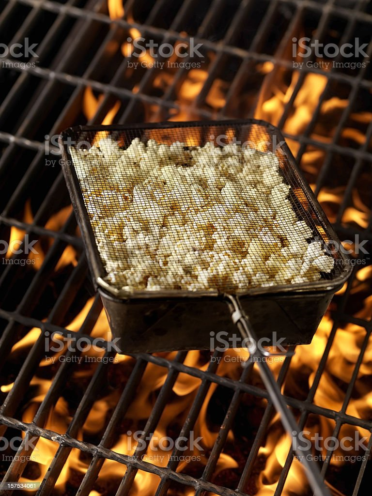 Popping Popcorn on the Campfire stock photo