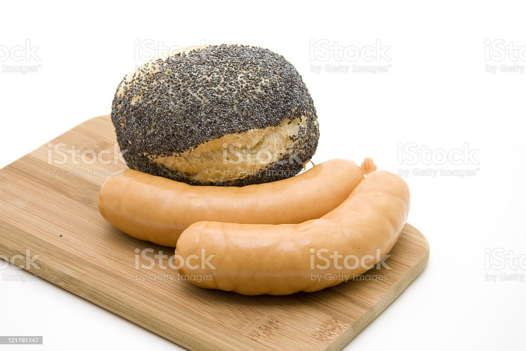 Poppy roll and goat sausage stock photo