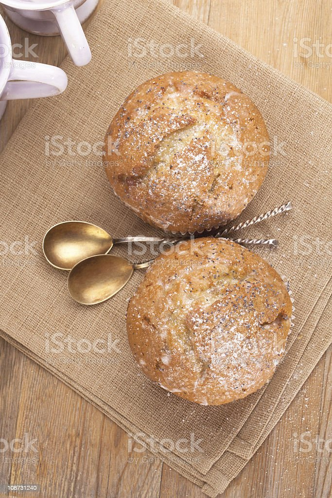 poppy seed and lemon muffins in rustic style stock photo