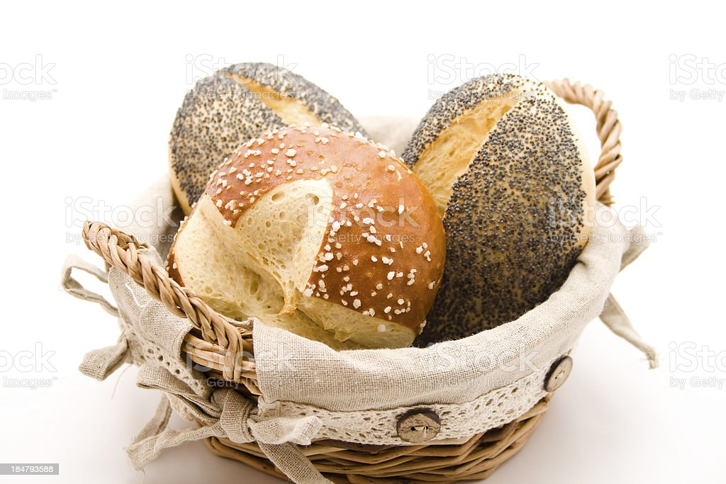 Poppy seed and lye bread roll in the basket stock photo