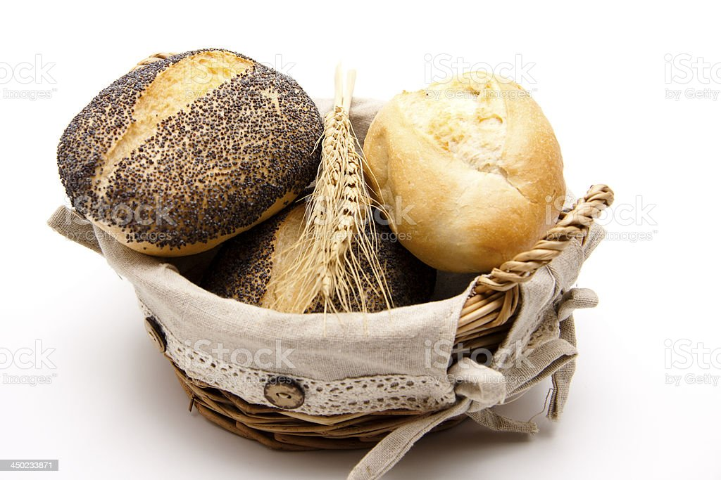 Poppy seed bread roll with wheat in the basket stock photo