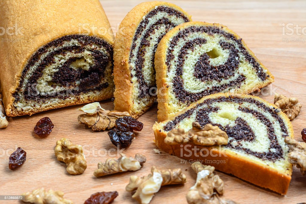 Poppy seed cake on wooden board. stock photo