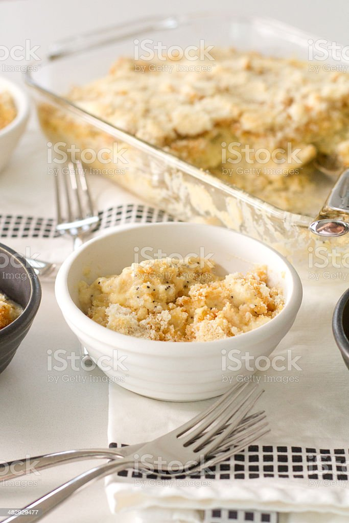 poppy seed chicken white bowl wide stock photo