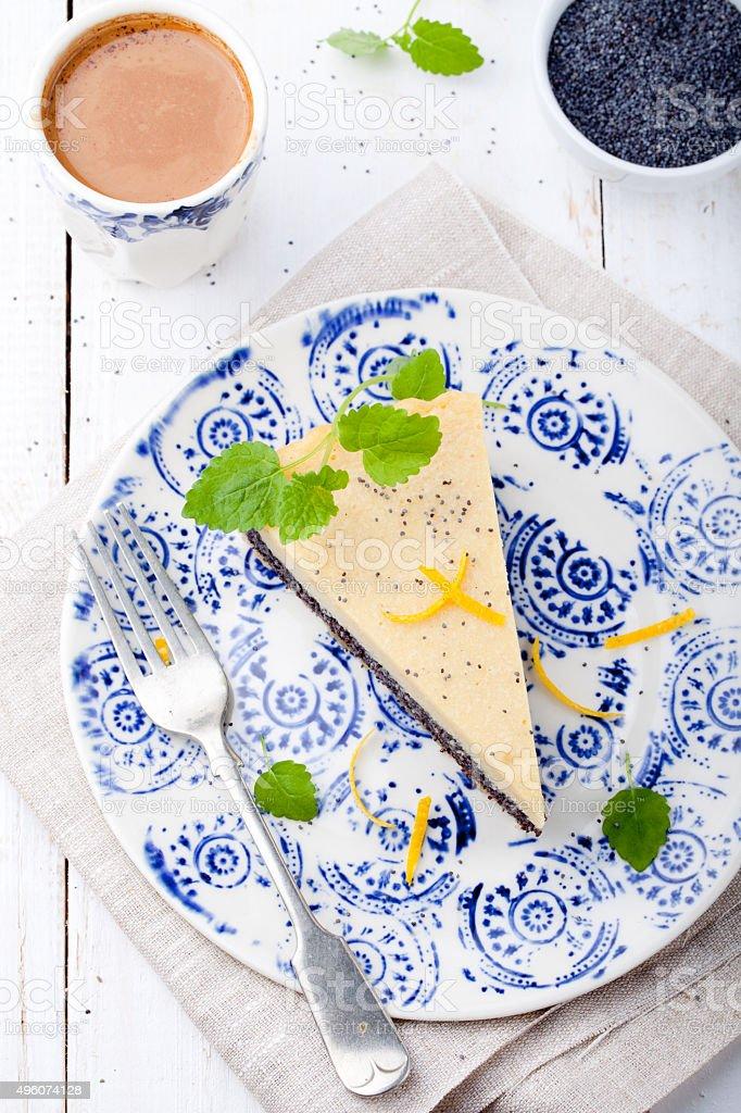 Poppy seed cream tart, cake, pie slice with lemon zest stock photo