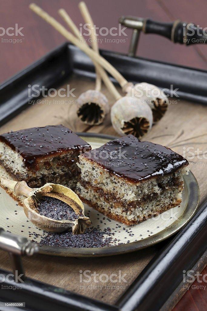 Poppy seed sponge cake with plum jam royalty-free stock photo