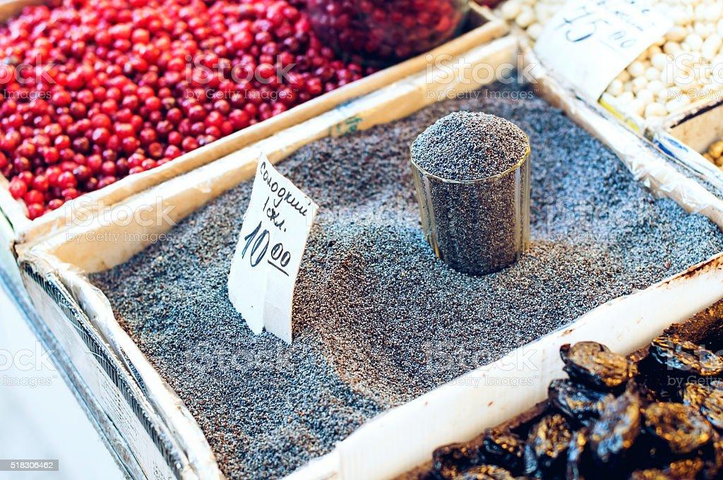 Poppy seeds on the market stock photo