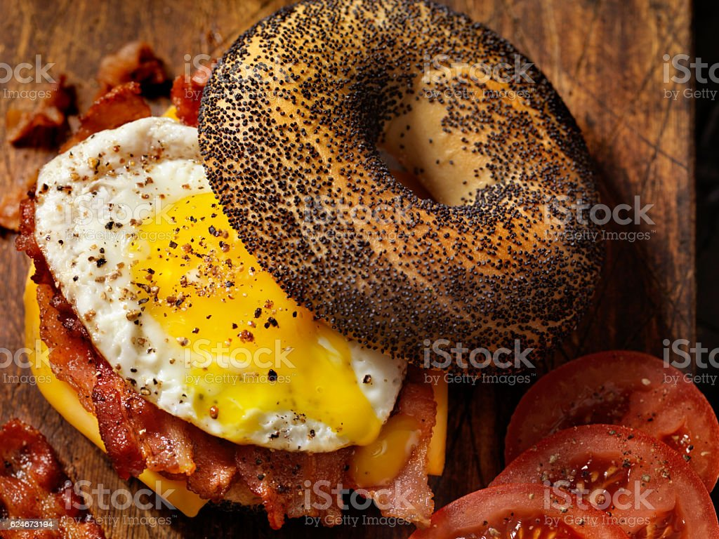 Poppyseed Bagel Sandwich with A Fried Egg, Bacon and Cheese stock photo