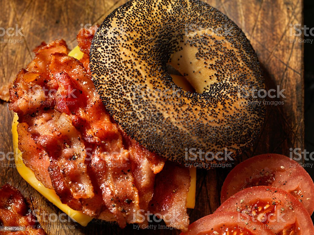 Poppyseed Bagel Sandwich with Bacon, Cheese and Tomatoes stock photo