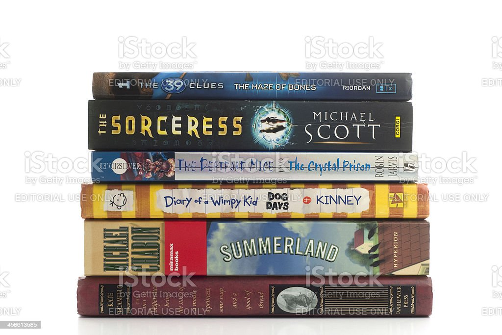 Popular childrens fiction stacked against white background stock photo