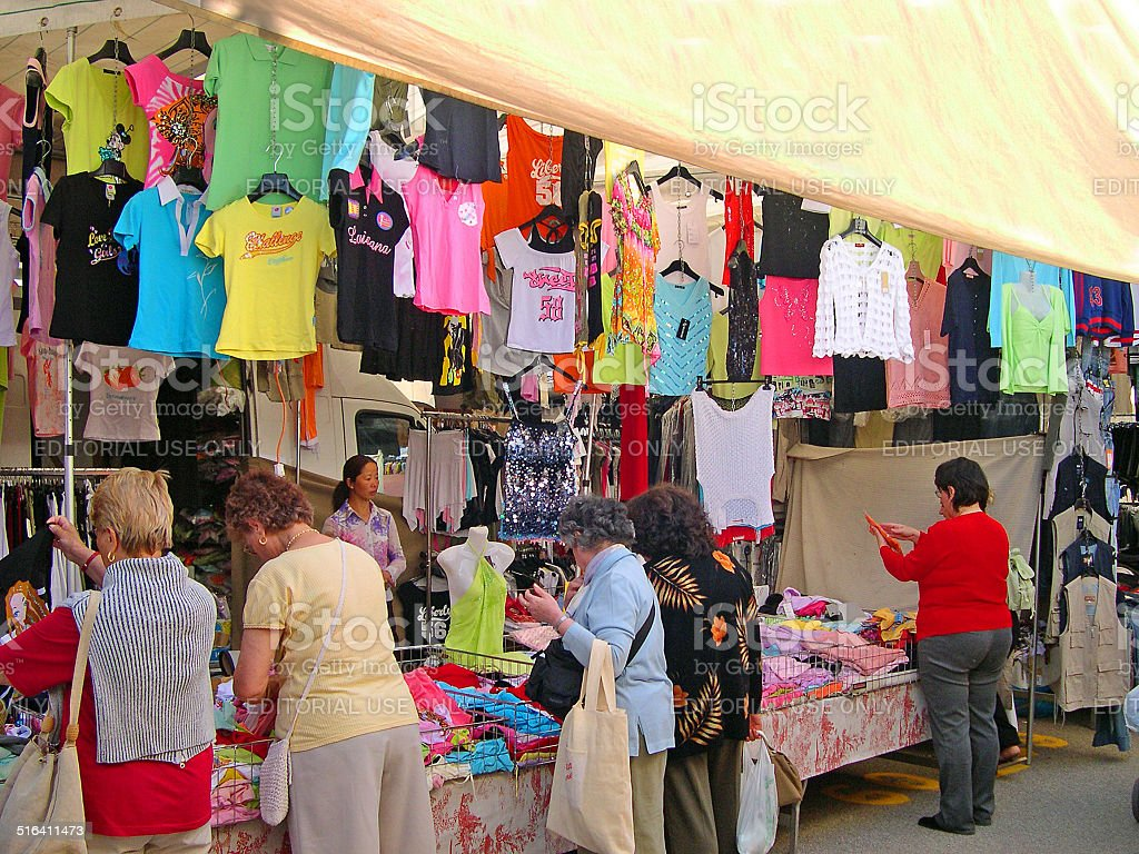 locals and tourists at the Wednesday outdoor market. The place is...
