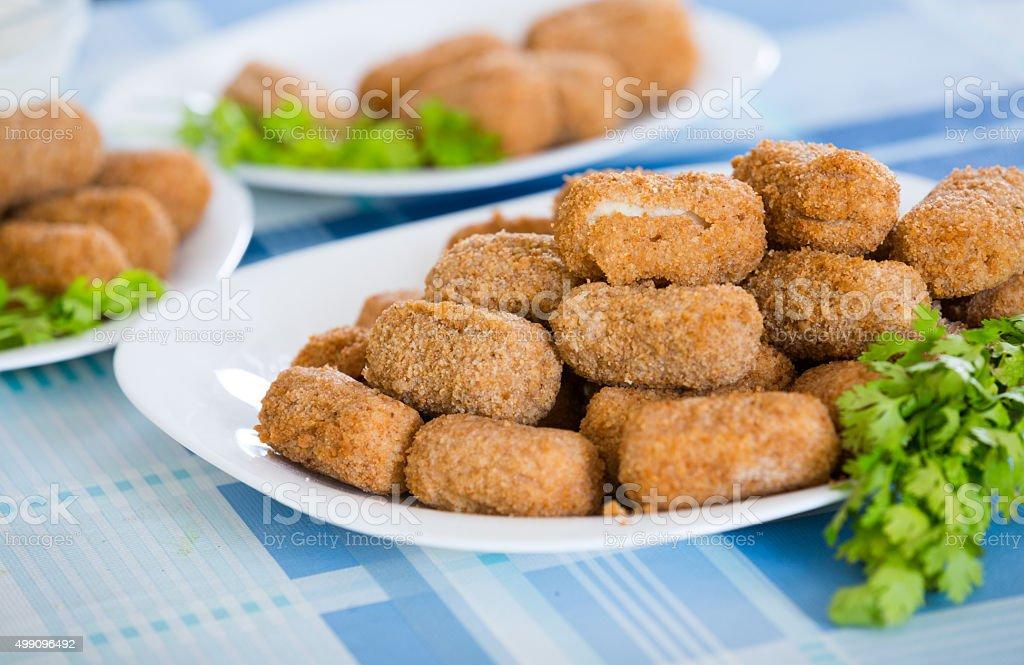 Popular side dish Croquetas fritas stock photo