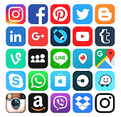 Popular social media icons printed on white paper