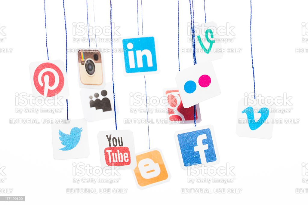 Popular social media website logos printed on paper and hanging stock photo
