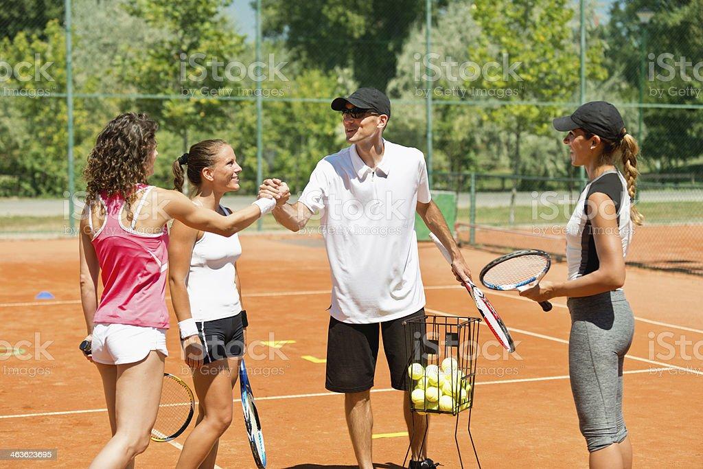 Popular tennis instructor royalty-free stock photo