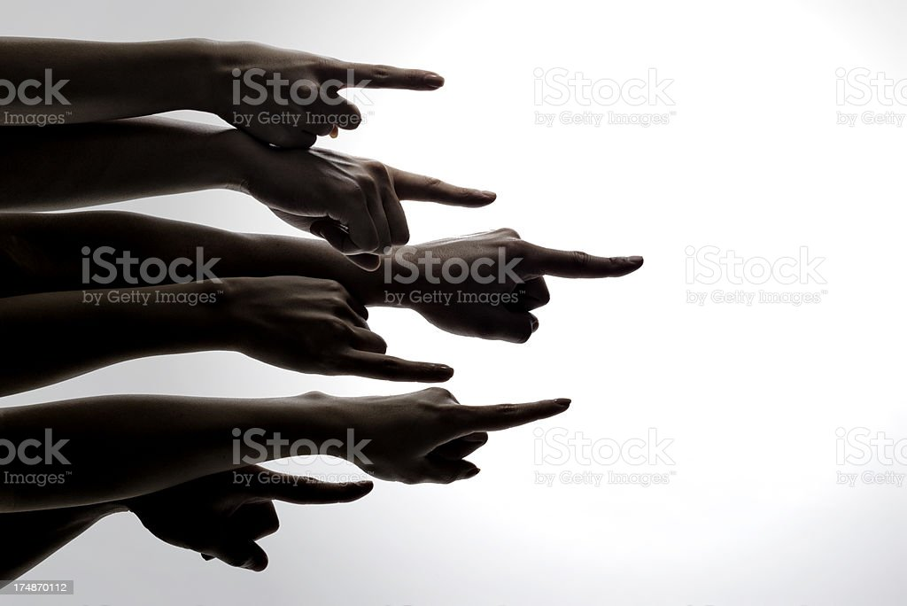 Population pointing in one direction. stock photo