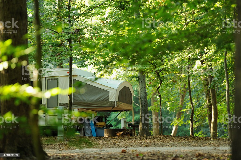 Popup rv in wooded campsite stock photo