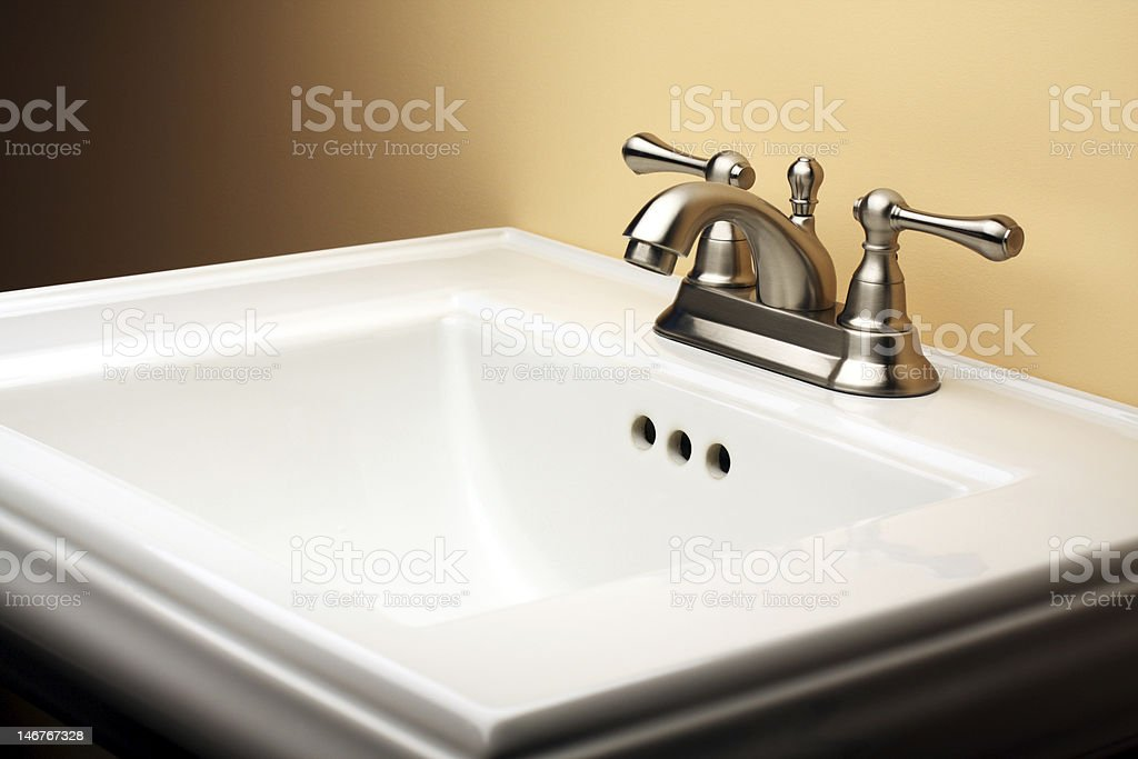 Porcelain Bathroom Sink with Brushed Nickel Faucet stock photo