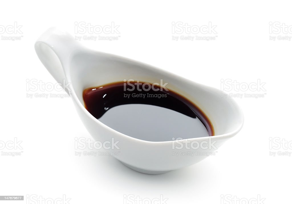 Porcelain boat filled with soy sauce stock photo