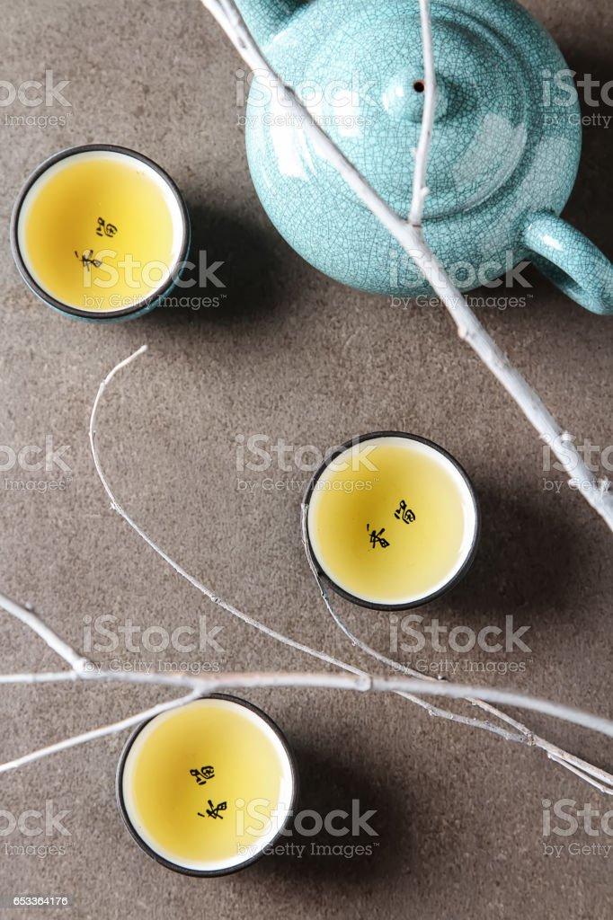 Porcelain chinese cups, steel teaspoon. Black, green, puerh, ool royalty-free stock photo