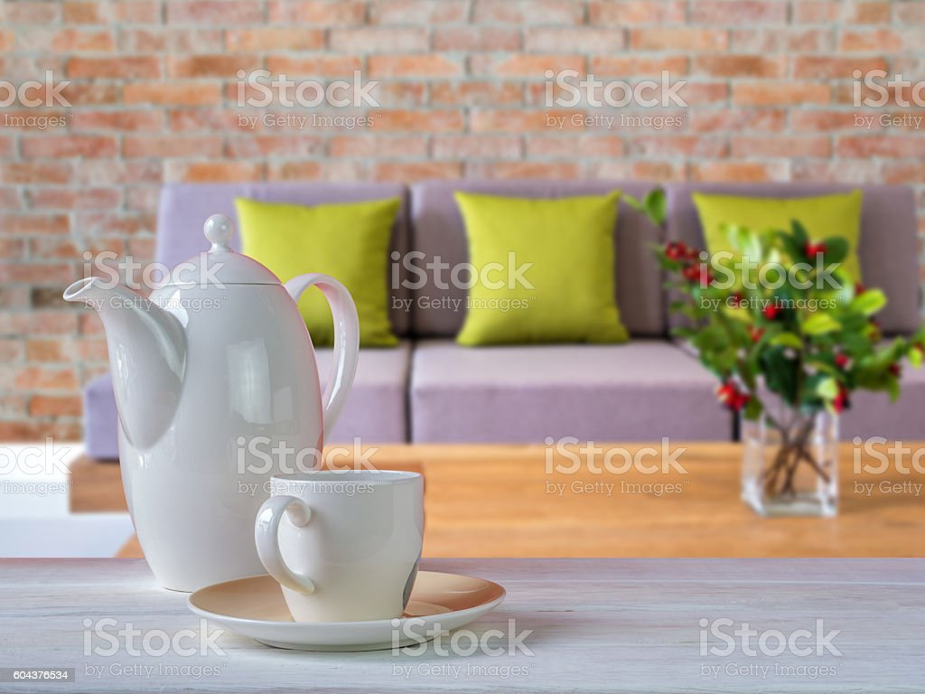 Porcelain coffee cup on table with Living room blurred background stock photo