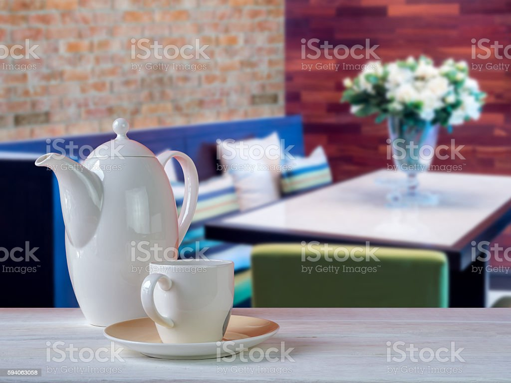 Porcelain coffee cup on wooden table with Dining room  background stock photo