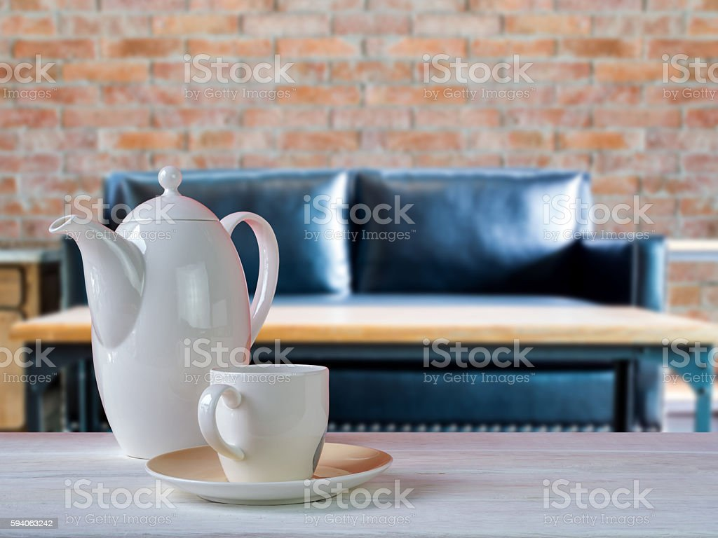 Porcelain Coffee Cup On Wooden Table With Living Room Background Royalty Free Stock Photo