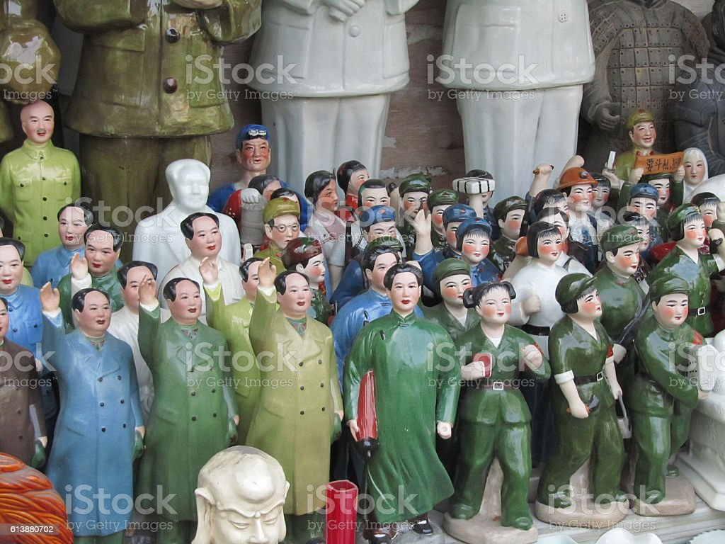 Porcelain Communist Figurines in Shanghai Antiques Market stock photo