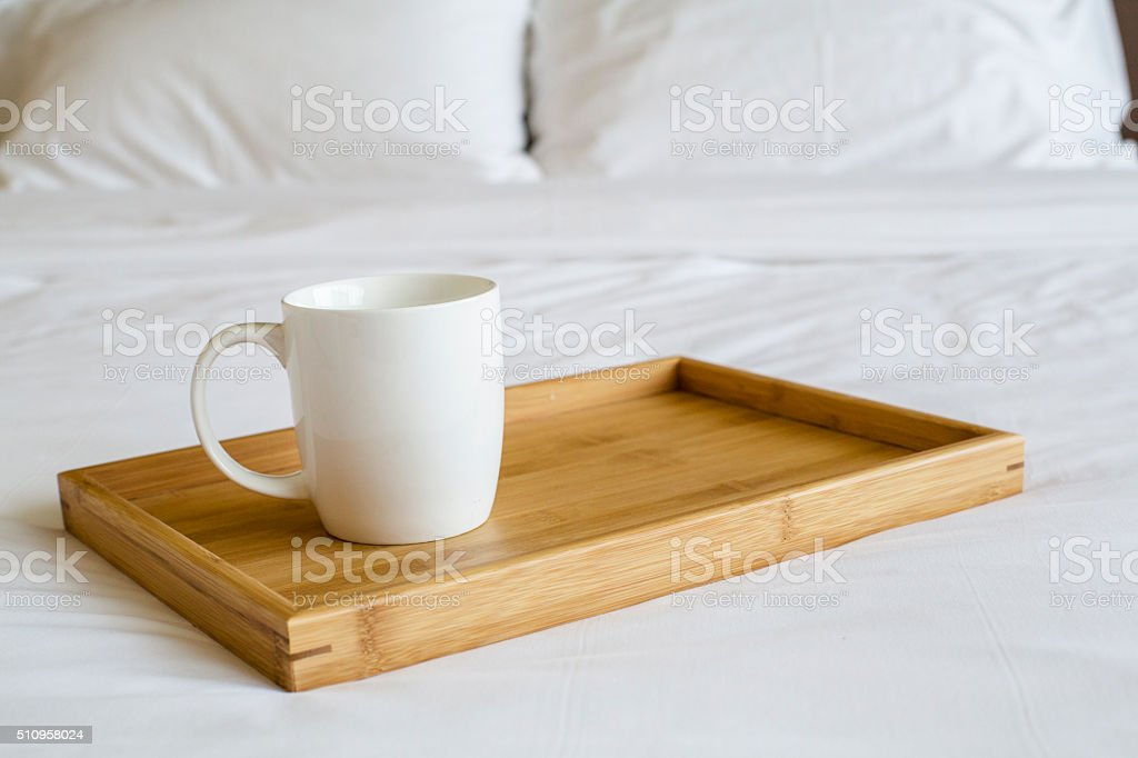 porcelain cup on bed stock photo