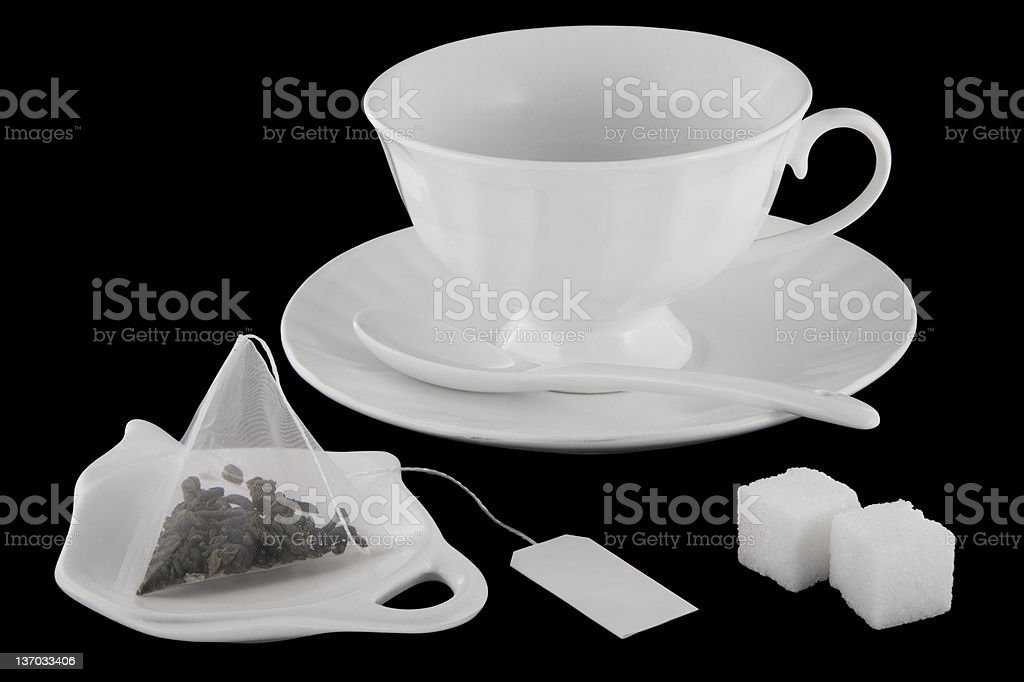 porcelain cup saucer spoon with tea bag and sugar royalty-free stock photo
