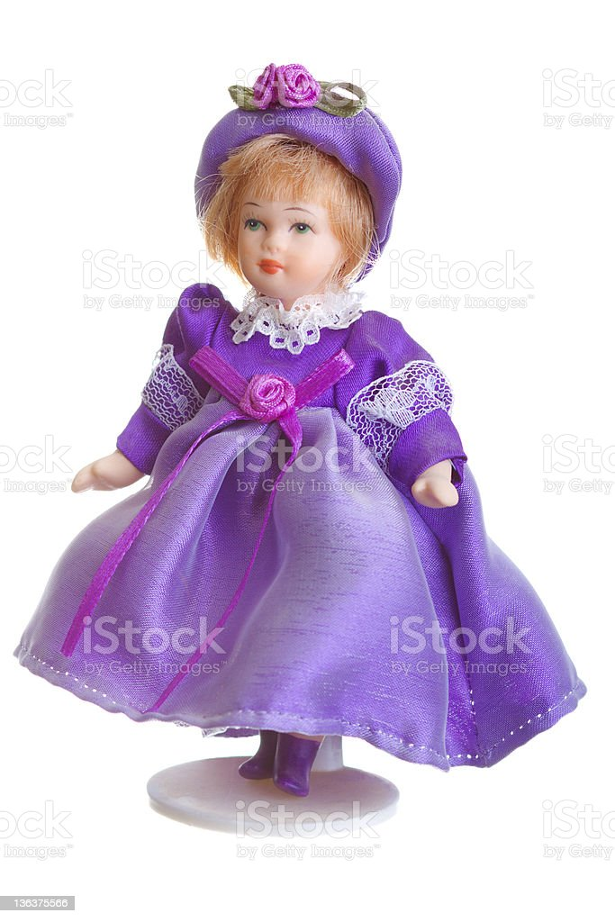 Porcelain Doll in purple dress stock photo