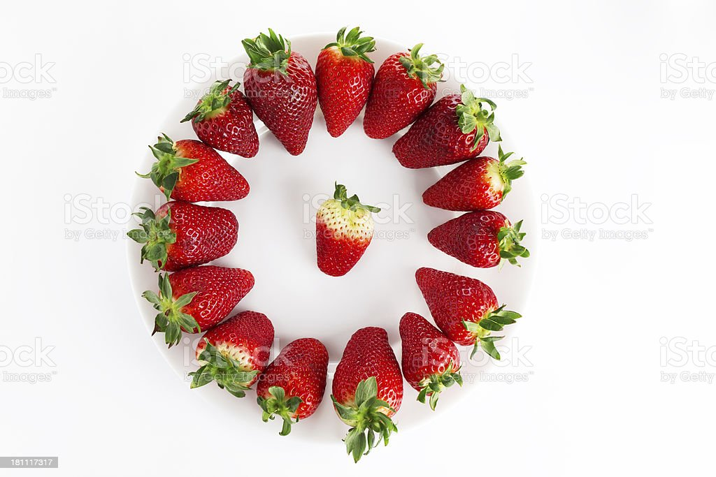 Porcelain plate and fresh strawberry royalty-free stock photo